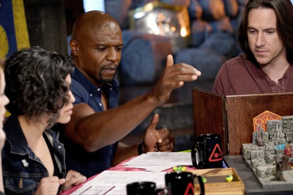 Actor Terry Crews and voice actors Matthew Mercer and Ashly Burch playing D&D